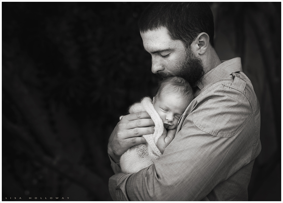 Dustin Ackley holds his newborn baby boy during their newborn portrait session in their home near Phoenix AZ