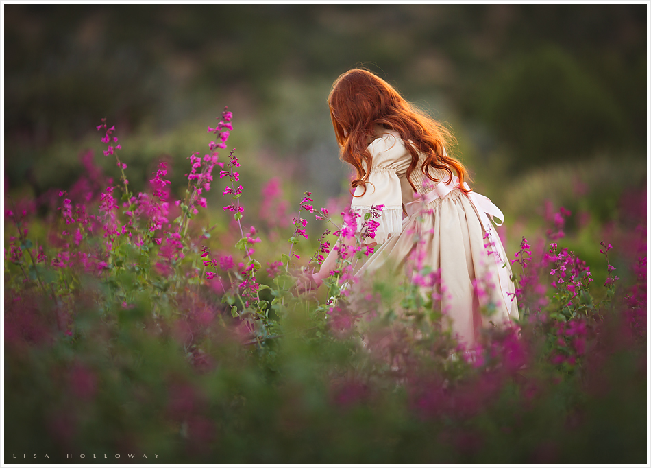 Beautiful redheaded little girl picks pink flowers outdoors for her child portrait session near las vegas ljholloway photography