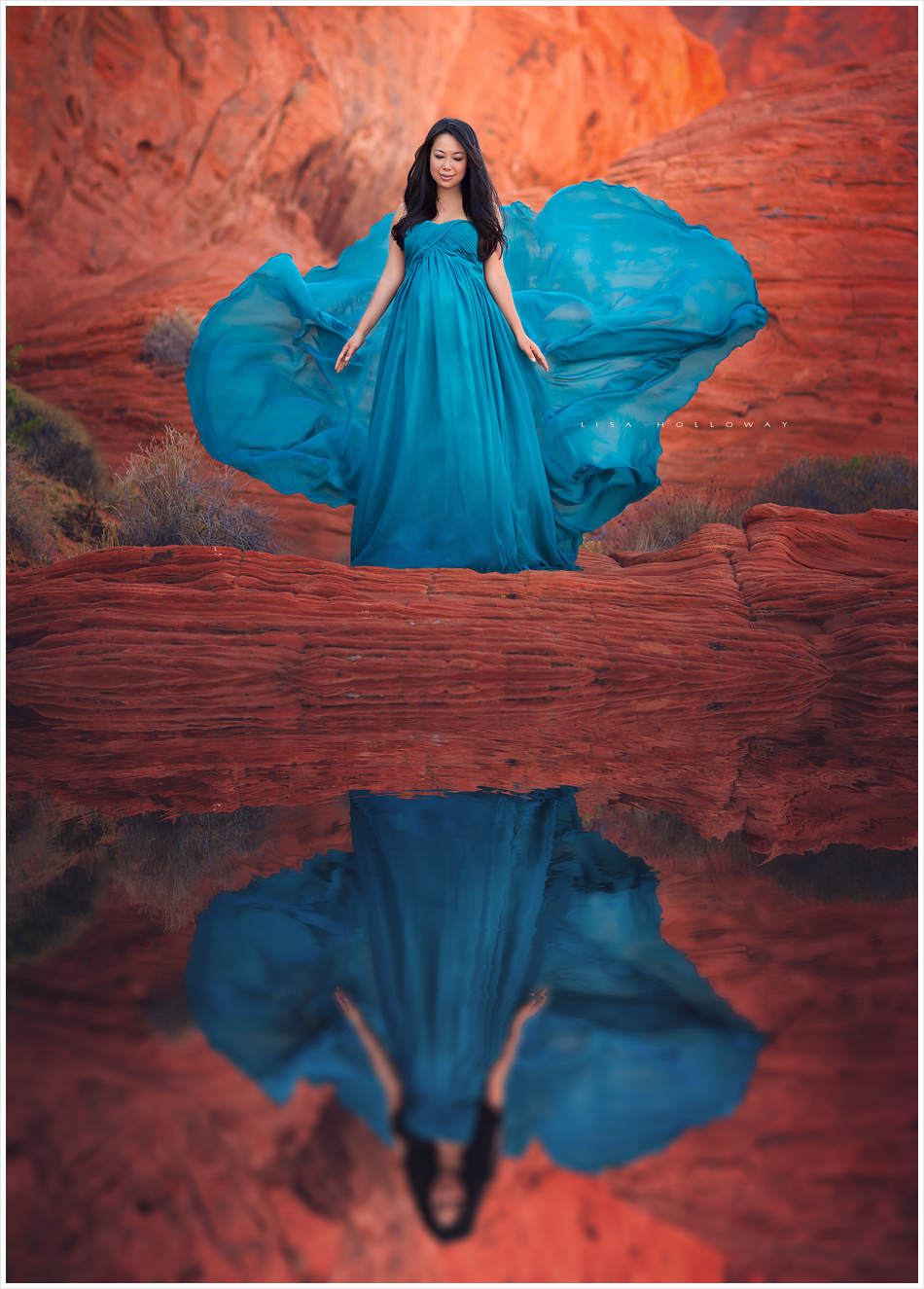 Beautiful pregnant woman poses for her maternity photo session on the red desert rocks outdoors near Las Vegas