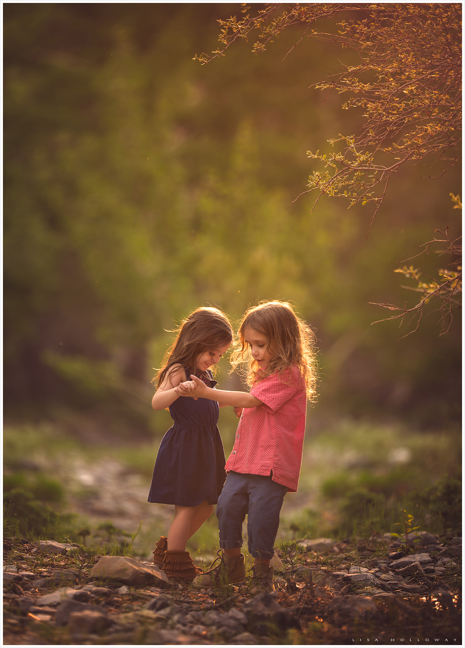 cute preschooler boy and girl dance together during a photo session outdoors in the forest near las vegas nevada
