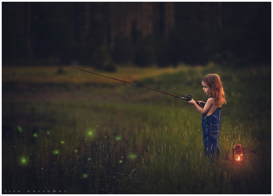 cute little boy with long curly hair fishes in a magical pond in the forest with fireflies