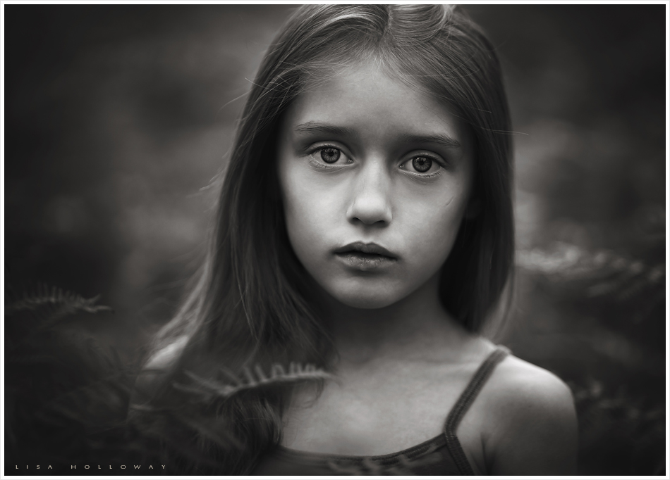 moody black and white portrait of a little girl taken outdoors near las vegas nevada