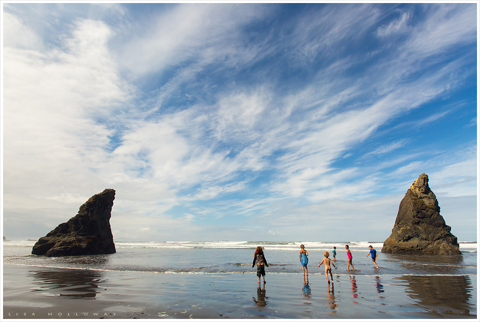6 little kids run and play at Ruby Beach in washington state