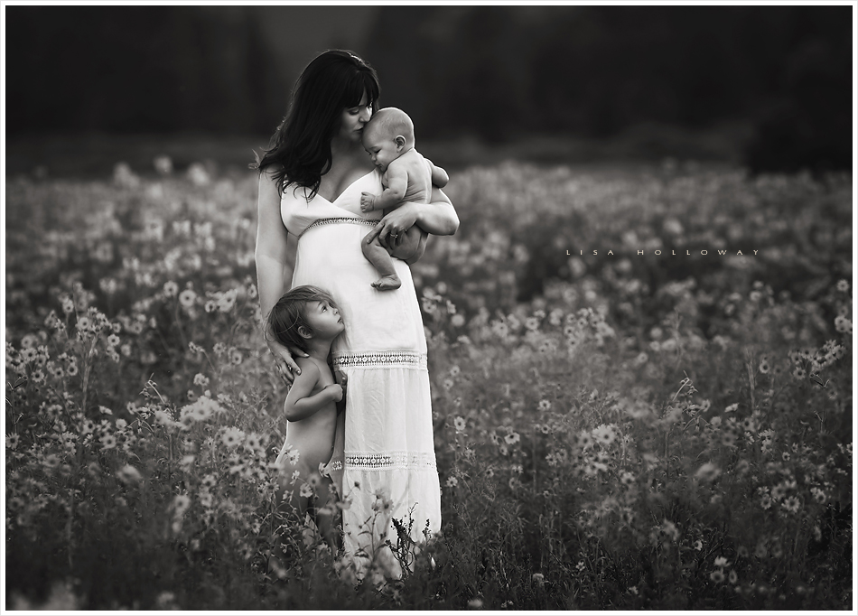 black and white portrait of a mother and her 2 children outdoors in a field of wildflowers near las vegas nevada