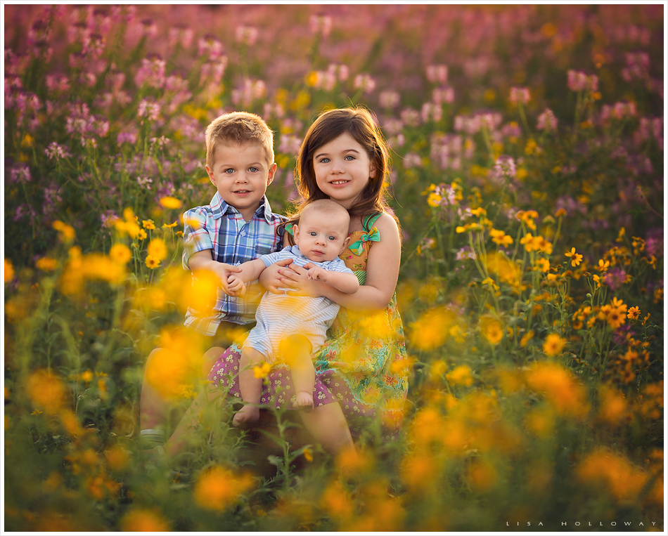 3 cute siblings pose for an outdoor portrait session near Las Vegas in the beautiful summer wildflowers
