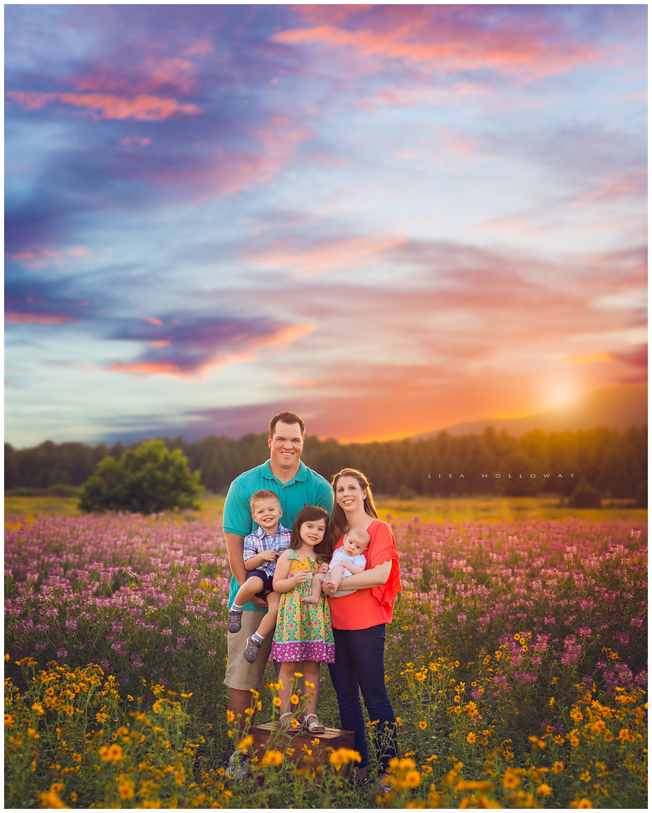 family poses for an outdoor family picture in a field of wildflowers near Las Vegas