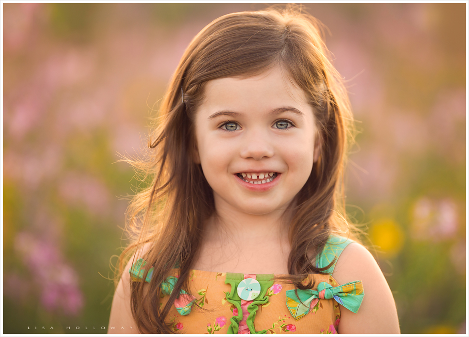 closeup portrait of a cute little girl in the wildflowers near williams arizona