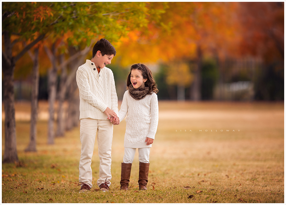 Adorable brother and sister are photographed outdoors in the fall colors during a familly photography session near Las Vegas.