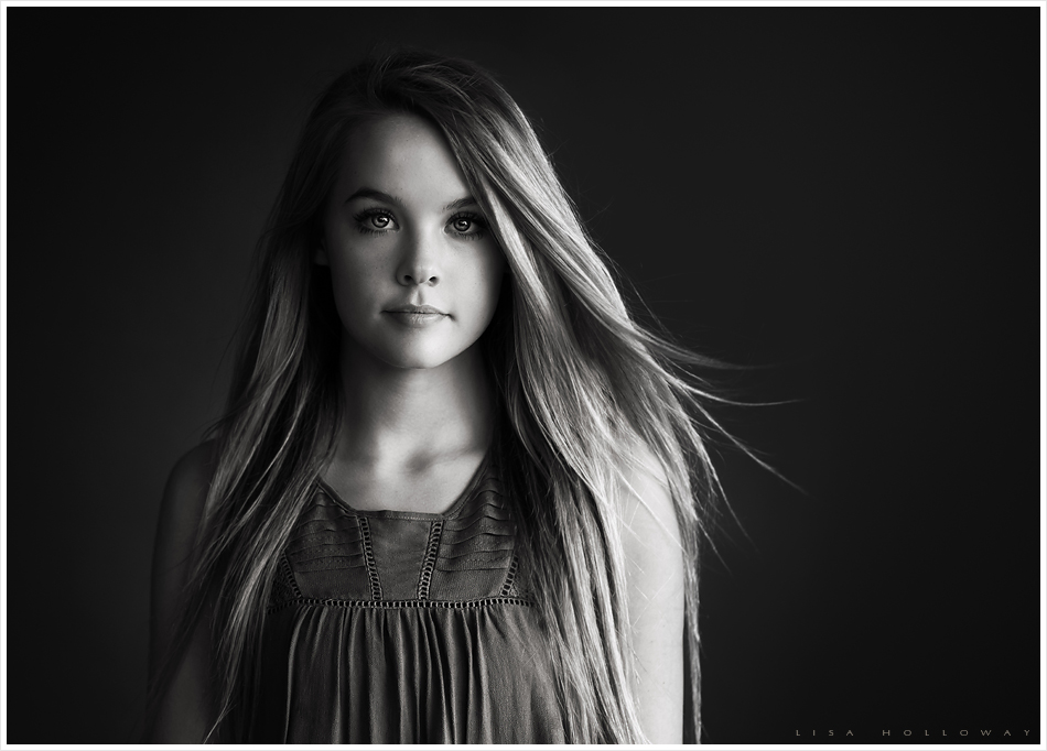 Black and white studio portrait of beautiful senior girl with long hair ljholloway photography is