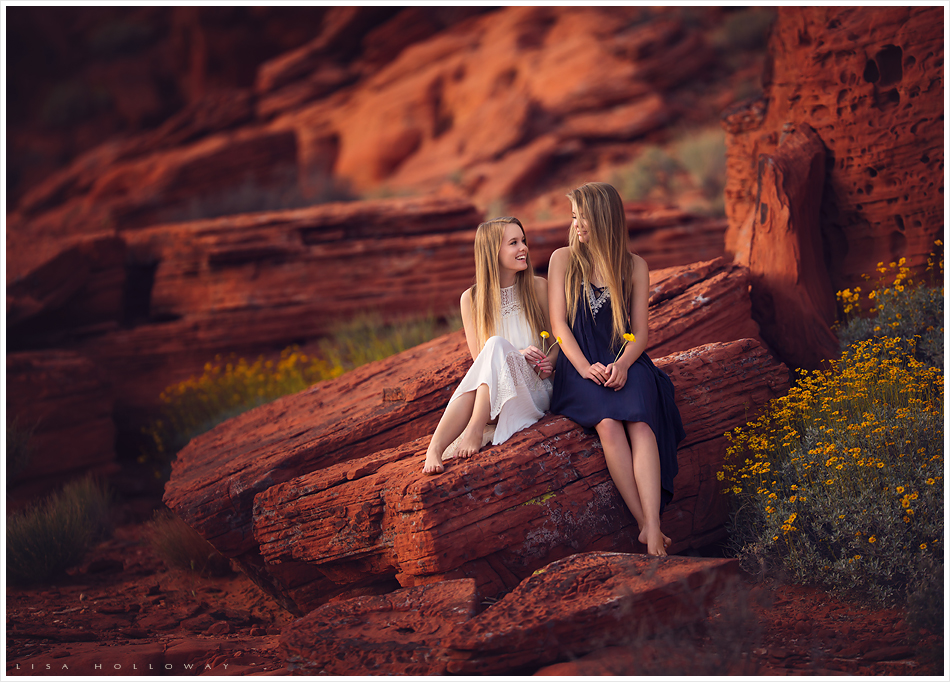 Outdoor portrait of twin sisters in the red rocks near Las Vegas. LJHolloway Photography is a Las Vegas Senior Photographer.